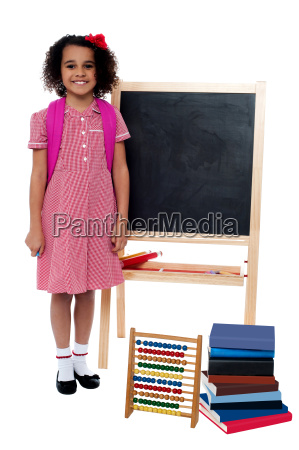 smiling school girl standing near the
