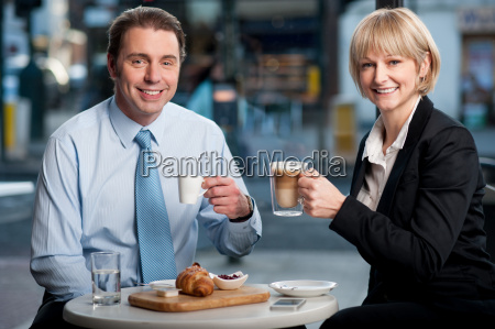 two corporates discussing business over snacks
