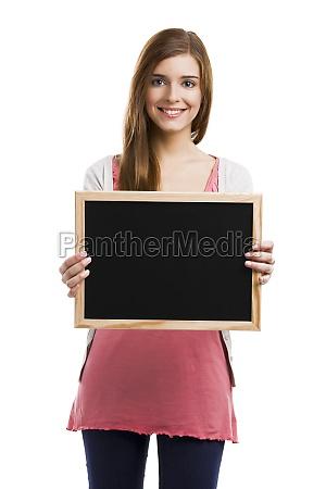 girl holding a chalkboard