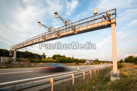 car passing through a toll gate