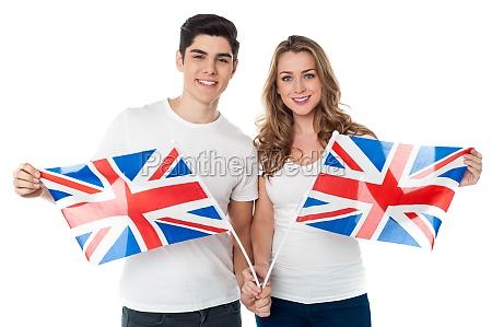 unterstuetzer des vereinigten koenigreichs mit flaggen