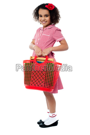 charming kid carrying school stationery