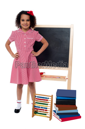 smiling little girl in school uniform
