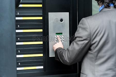 man entering security code to unlock