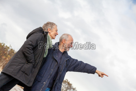 older senior couple laughing happily on