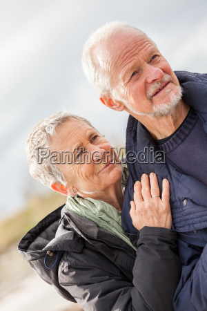 older adult happy couple walks on