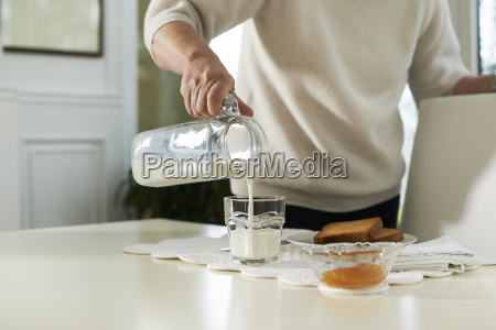 portrait of senior woman having breakfast