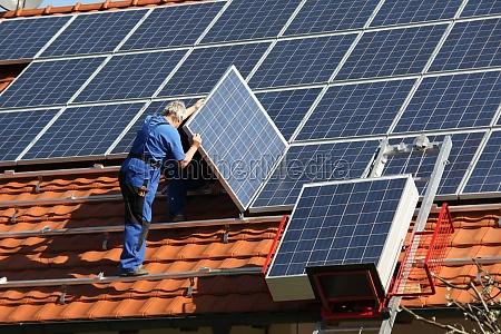 workman is mounting solar paneels