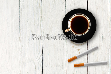 cup of coffee with cigarettes on