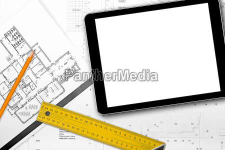 blank tablet and tools on house
