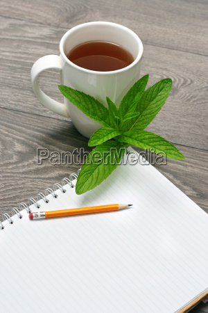 notebook and cup of tea