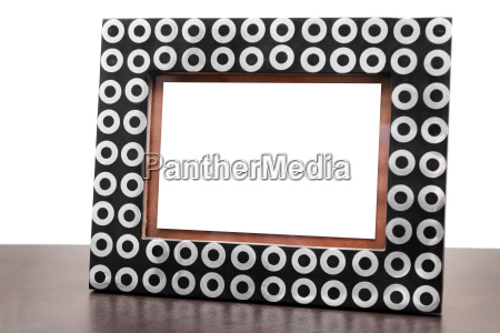 blank picture frame on dark brown