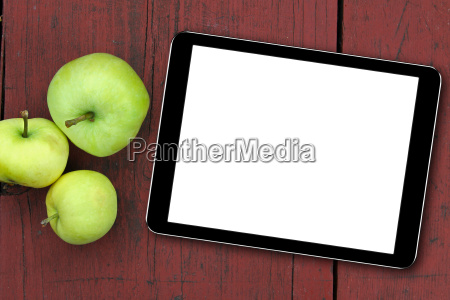 empty tablet and apples on the
