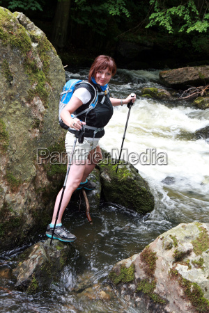 hiker on a raging river