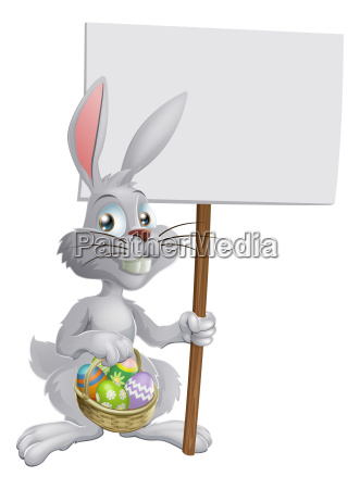 easter bunny with eggs and sign