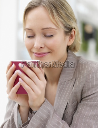 young beautiful woman drinking coffee
