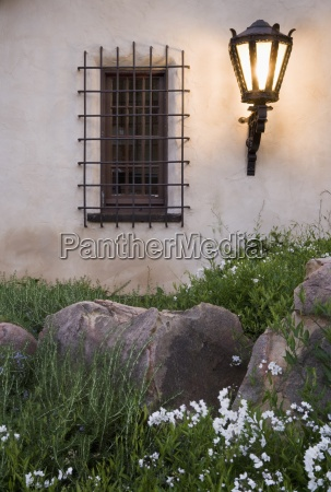 wrought iron exterior light near window