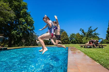 girls cousins swimming pool summer