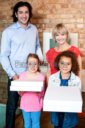beautiful little girls holding pizza boxes