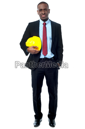 handsome engineer holding yellow helmet