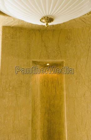 large ceiling lamp and gold textured