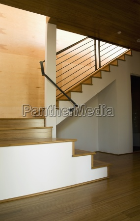 modern stairwell with wrought iron bannister