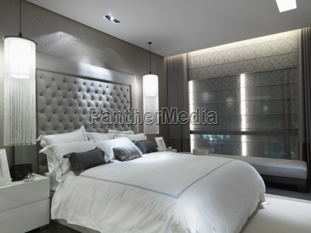 large bed with collection of throw