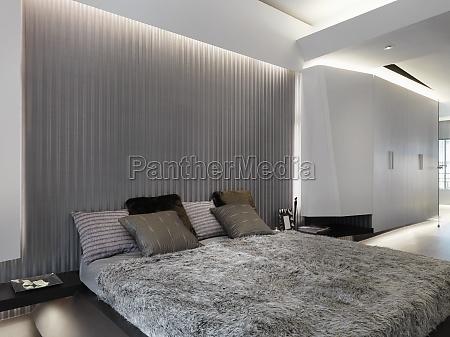 modern platform bed with fur comforter