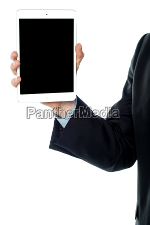guy holding tablet pc cropped image