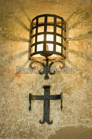 illuminated light with wrought iron covering