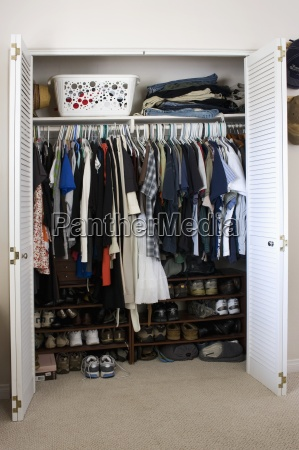 clothes and shoes in cluttered closet