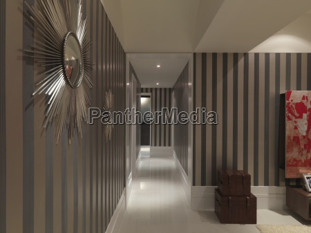 hallway in home with striped wall