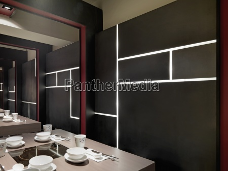 black wall with built in lights
