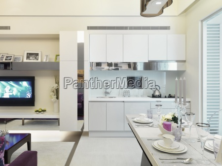 white kitchen and dining area in
