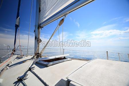 sailboat yacht sailing in blue sea