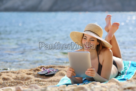 pretty woman reading a tablet reader