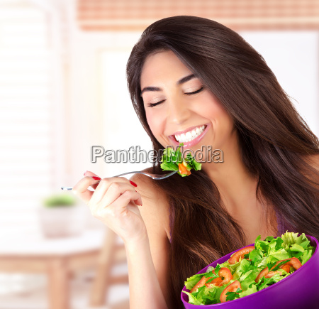 cute girl eating salad