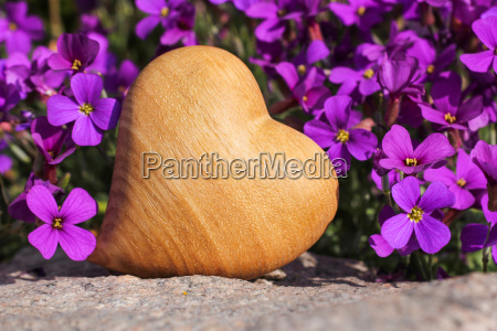 wooden heart with blue pillow