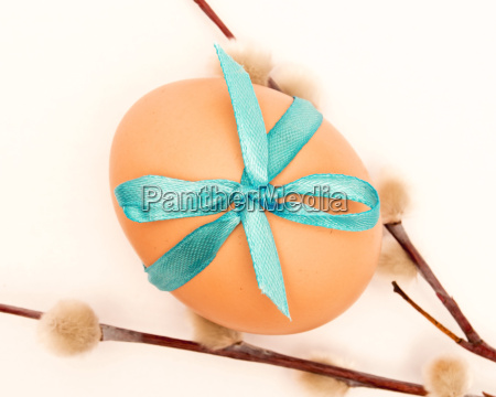 egg tied with a ribbon