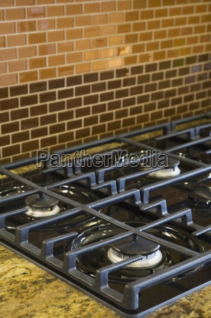 gas stovetop and brick tiles