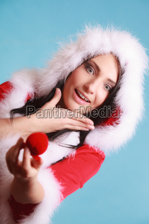woman santa claus costume holds gift