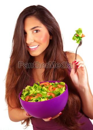 sportive girl eating fresh salad