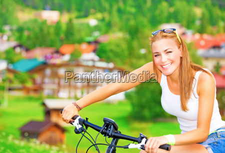 cheerful girl in bicycle tour