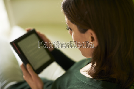girl studying literature with e book