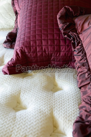 red throw pillows on a large