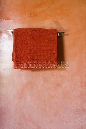 red towel on towel rack on