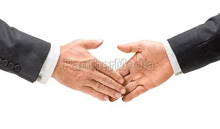 geschaeftsleute reichen sich die hand