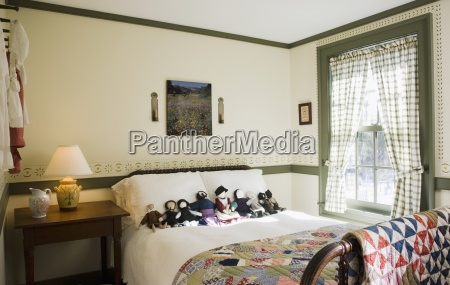 small colonial bedroom with collection of