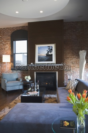 contemporary living room with brick wall