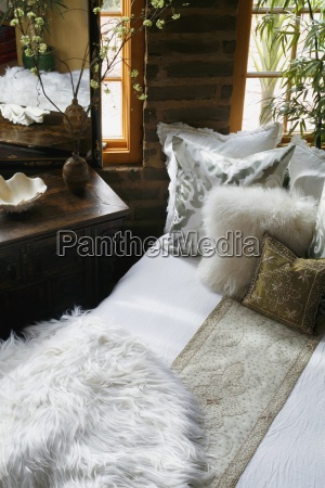 white and gold bed runner and